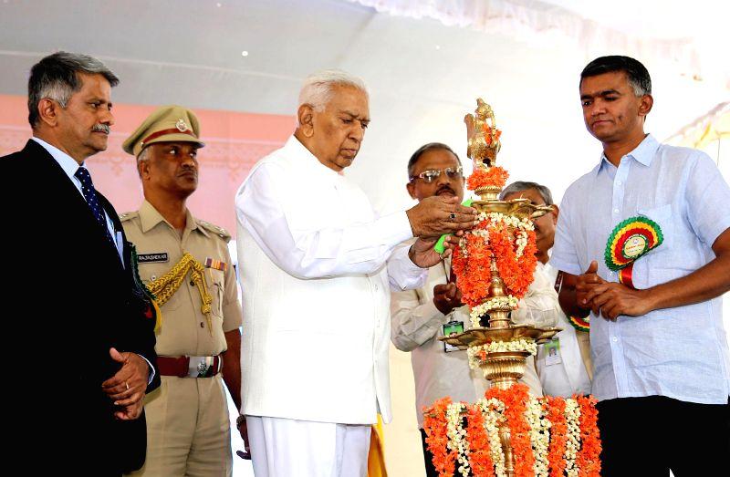 Karnataka Governor Vajubhai Vala lighting a lamp to inaugurate Krishi Mela - 2014 organised by University of Agricultural Sciences at Gandhi Krishi Vignayana Kendra (GKVK), also seen are ..