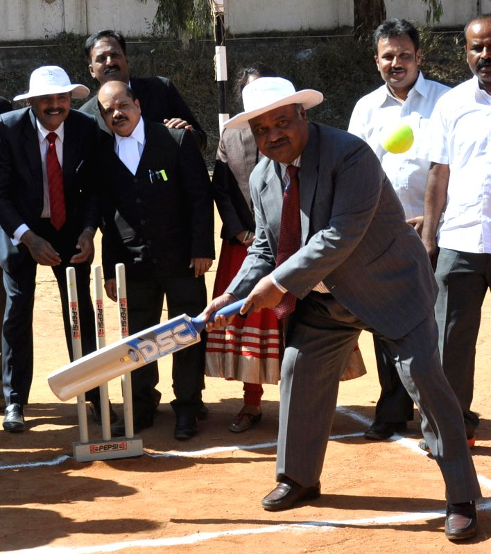 Karnataka High Court Judge, Justice K L Manjunath in action during the inauguration of the `Vakil Cup` advocates' cricket tournament at YMCA grounds, in Bengaluru on Feb 25, 2015.