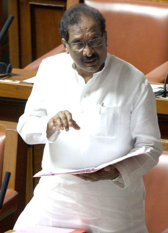 Karnataka Home Minister K J George addresses in the Karnataka assembly, in Bengaluru on March 24, 2015. - K J George