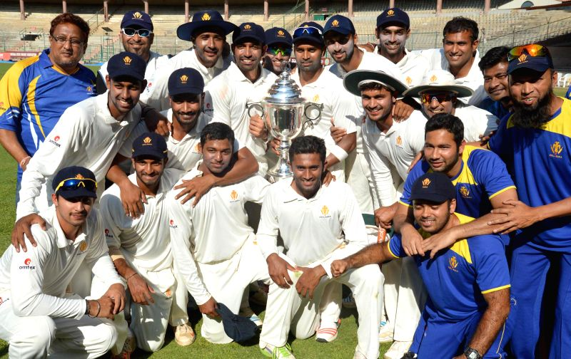 Karnataka players celebrate after winning the Irani Cup at M Chinnaswamy Stadium, in Bengaluru on March 20, 2015. Karnataka defeatedRest of India team by 246 runs.