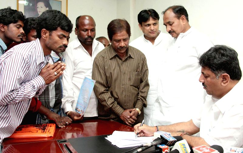 Karnataka Power Minister D K Shivakumar listens to the grievances of the Congress workers during his visit to the KPCC office, in Bengaluru on March 7, 2015.