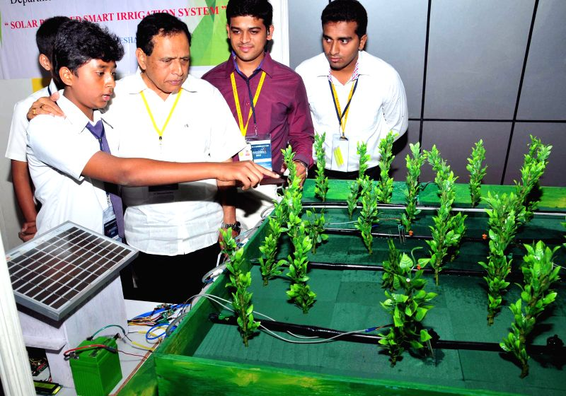 Karnataka Primary and Secondary Education Minister Kimmane Rathnakar interacts with students during `Science and Engineering Fair 2015` in Bengaluru on Feb 26, 2015. - Kimmane Rathnakar