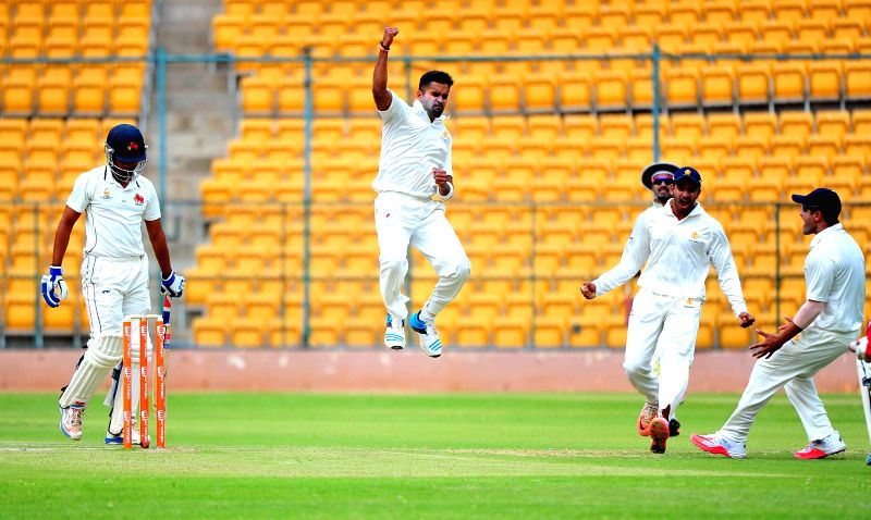Karnataka skipper R Vinay Kumar celebrates fall of a wicket during a Ranji Trophy Semi Final match between Karnataka and Mumbai at M Chinnaswamy Stadium, in Bengaluru on Feb 25,2015. - R Vinay Kumar