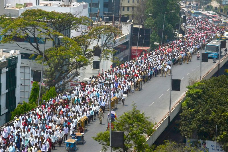 Karnataka State Gram Panchayat Employees stage a demonstration to demand implementation of M S Swamy report and a hike in their salaries, in Bengaluru on March 24, 2015.