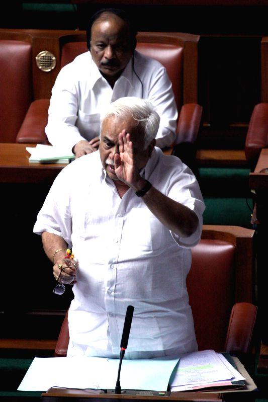 Karnataka Tourism Minister R V Deshpande during a joint Karnataka Legislative Assembly at Vidhan Soudha, in Bengaluru on Feb. 4, 2015. - R V Deshpande