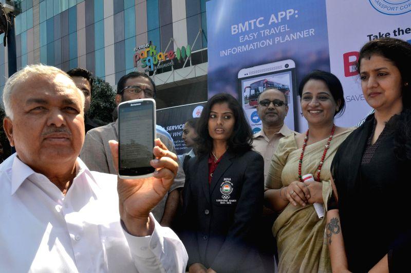 Karnataka Transport Minister Ramalinga Reddy launches the `Easy Travel Information Planner` - a mobile application, in Bengaluru on Jan 12, 2015. - Ramalinga Reddy