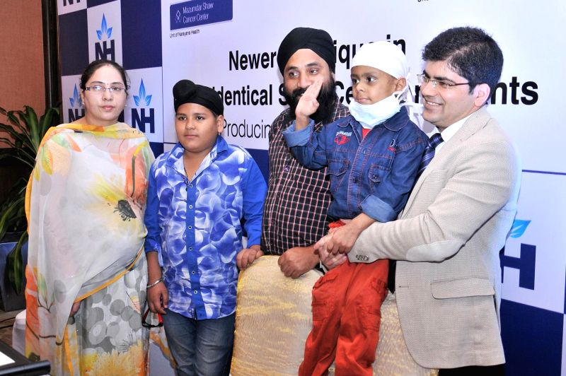 Kulraj, a four-year-old boy, who was cured of Amegakaryocytic Thrombocytopenia evolving into Aplastic Anemia - a rare bone marrow disease, during a press conference with his parents after .