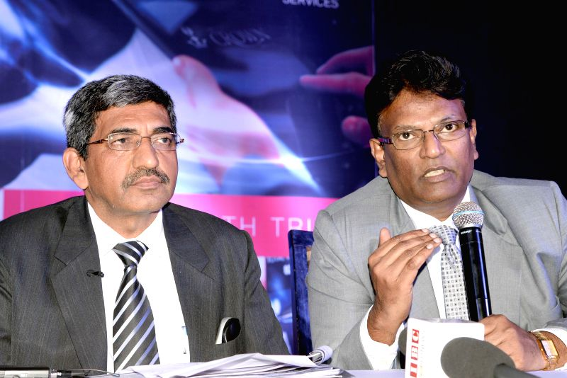 (L to R) MD and CEO of Lakshmi Vilas Bank, Rakesh Sharma with COO of Lakshmi Vilas Bank, Vidyasagar Akkidas address during a press conference in Bengaluru on Feb. 2, 2015. - Rakesh Sharma