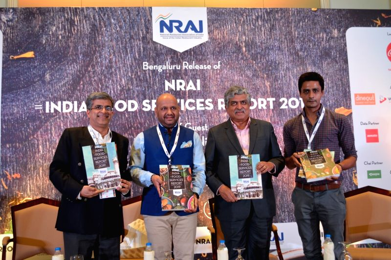 Bengaluru:  (L to R) NRAI Trustee and Past President Samir Kuckreja, President Rahul Singh, Infosys Co-Founder and Chairman Nandan Nilekani and NRAI Bengaluru Chapter Head Chef Manu Chandra during the launch of the National Restaurant Association of