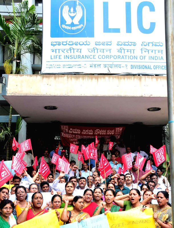LIC workers stage a demonstration to press for their demands in front of LIC office in Bengaluru, on March 9, 2015.