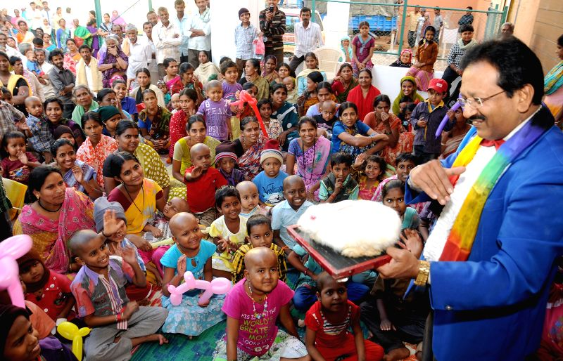 Magician S.P.Nagendra Prasad performs during a programme organised to celebrate Children's Day at a hospital in Bengaluru on Nov 23, 2014.