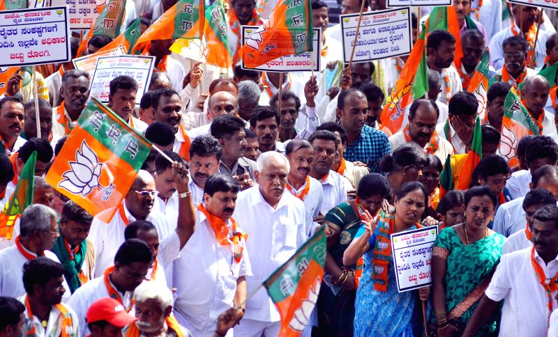 Members and activists of BJP Raita Morcha led by​ party​ ​vice ​president BS Yeddiyurappa​ during a statewide protest against irregular power supply, in Bengaluru on Nov 18, 2014.​ Also ...