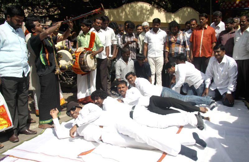 Members of Kannada Chaluvali Vatal Paksha led by its chief Vatal Nagaraj protest against `Made Made Snana` at Kukke Subrmanya Temple, in Bengaluru on Nov 27, 2014.