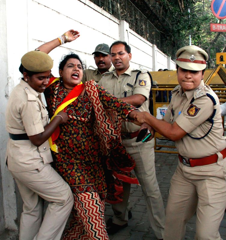 Members of Karnataka Rakshana Vedike courting arrest during their protest against Karnataka Governor's Hindi speech for upcoming joint session in Bengaluru on Jan. 30, 2015.