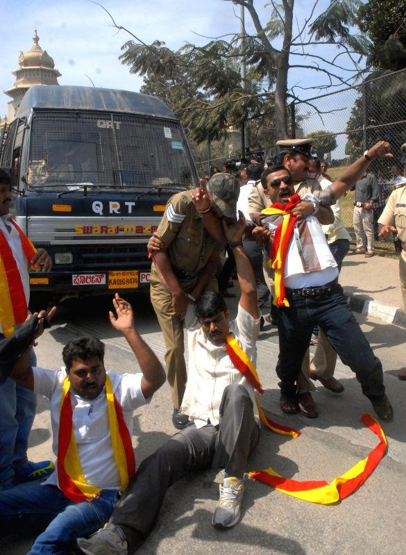 Members of Karnataka Rakshana Vedike courting arrest during their protest against Karnataka Governor`s Vajubhai Rudabhai Vala Hindi speech during a joint Karnataka Legislative Assembly at .