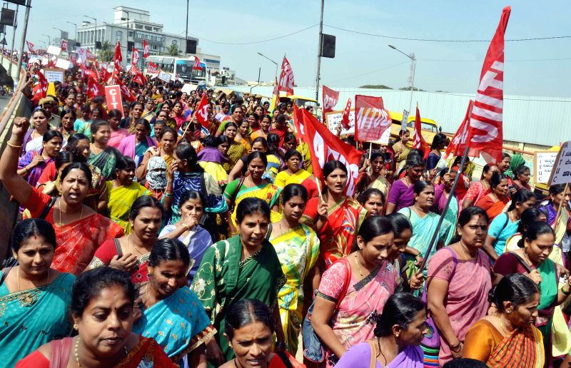 Members of Karnataka State Anganavadi Workers Association stage a demonstration to press for their various demands in Bengaluru on Feb. 2, 2015.