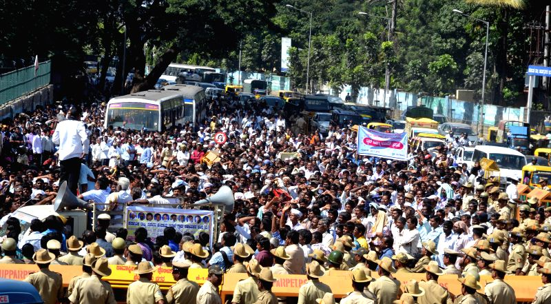 Members of Karnataka State Revenue Department Rural Helpers Association participate in a rally to press for their various demands in Bengaluru, on Nov 24, 2014.
