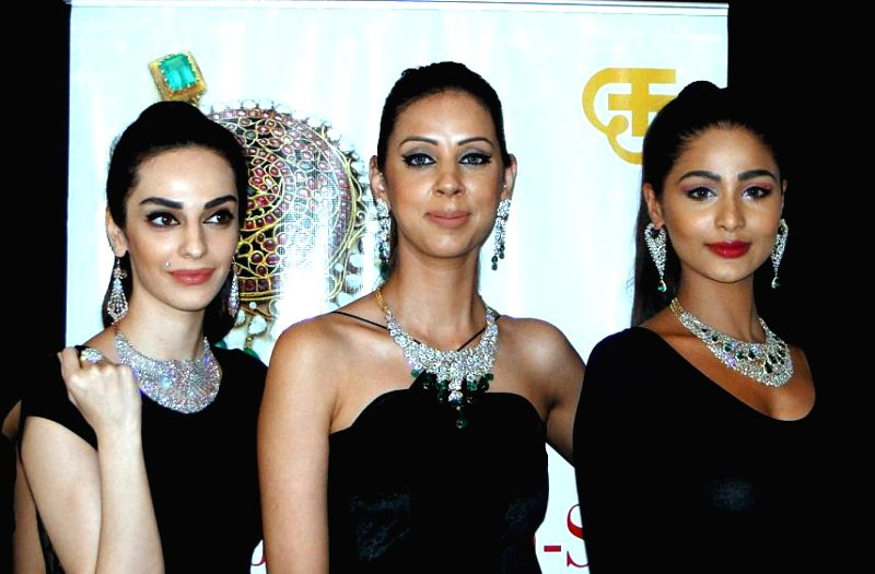 Models showcases jewellery collection during a jewellery fashion show in Bengaluru on Feb. 2, 2015.