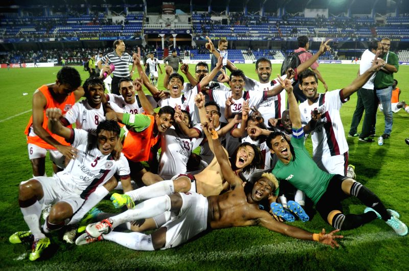 Mohun Bagan players celebrate their victory in the final I-League match against Bengaluru FC at Kanteerva Stadium in Bengaluru on May 31, 2015.