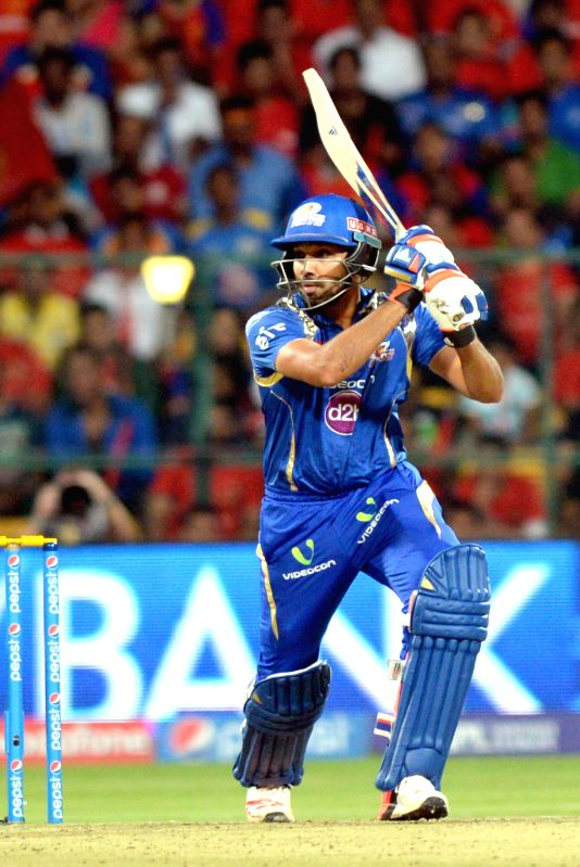 Mumbai Indians batsman Rohit Sharma in action during an IPL-2015 match between Royal Challengers Bangalore and Mumbai Indians at M Chinnaswamy Stadium, in Bengaluru, on April 19, 2015. - Rohit Sharma