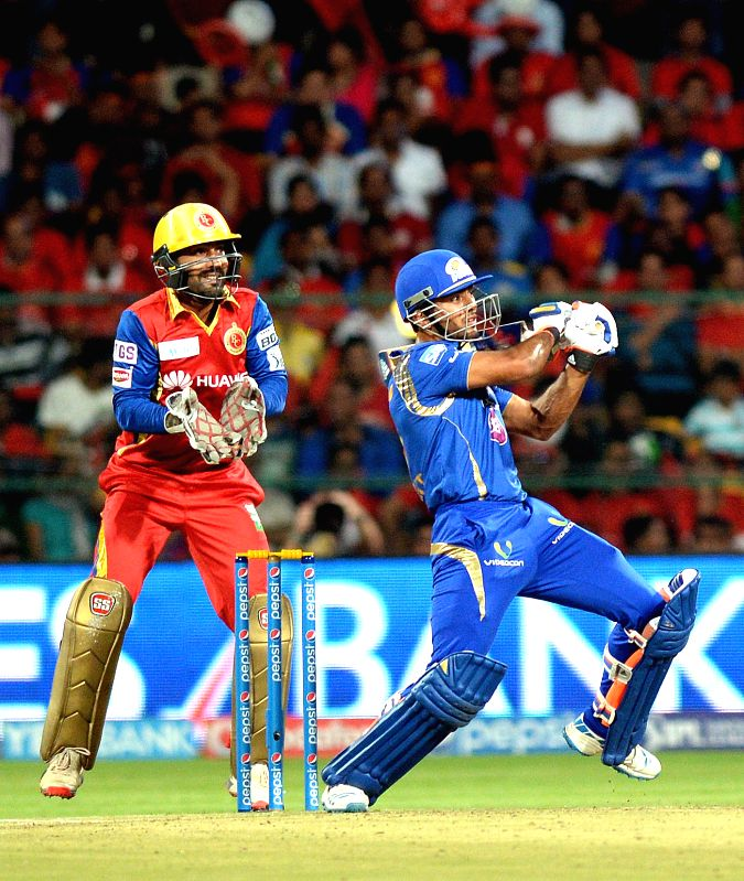 Mumbai Indians batsman Unmukt Chand in action during an IPL-2015 match between Royal Challengers Bangalore and Mumbai Indians at M Chinnaswamy Stadium, in Bengaluru, on April 19, 2015. - Unmukt Chand
