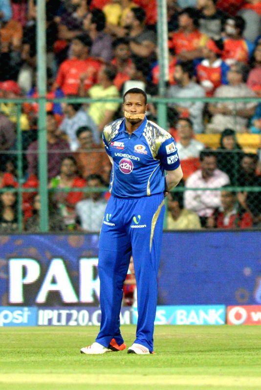 Mumbai Indians player Kieron Pollard during an IPL-2015 match between Royal Challengers Bangalore and Mumbai Indians at M Chinnaswamy Stadium, in Bengaluru, on April 19, 2015.
