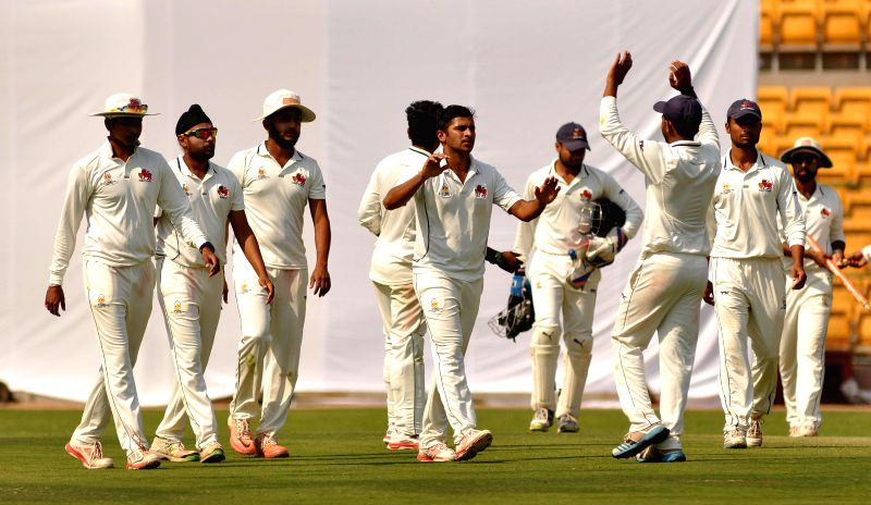 Mumbai players celebrates fall of a wicket during a Ranji Trophy Semi Final match between Karnataka and Mumbai at M Chinnaswamy Stadium, in Bengaluru on Feb 26, 2015.