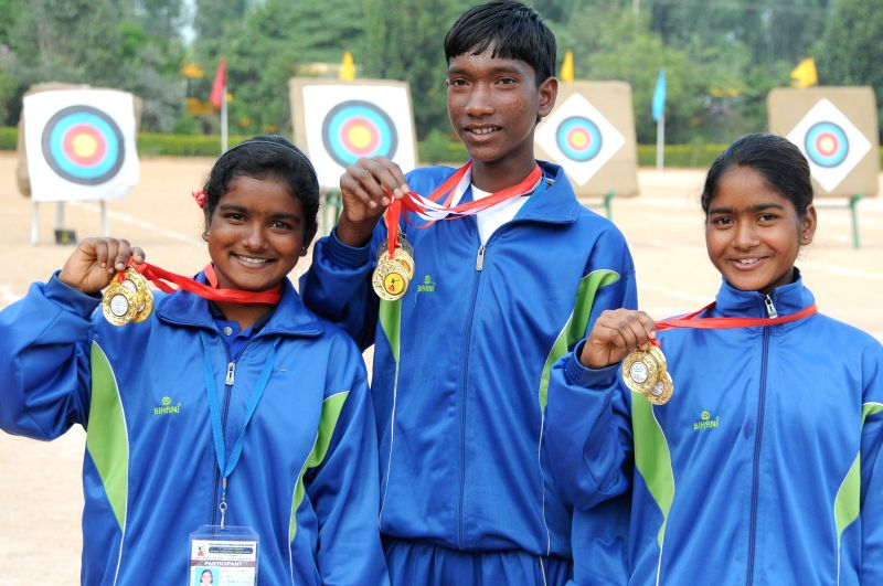 Nasima Purthy and Nanika Purthy (winners of sub junior girls session) and Niroj Soren (winner in Junior session) during last day of the 17th National Varanasi Archery Competition at ...
