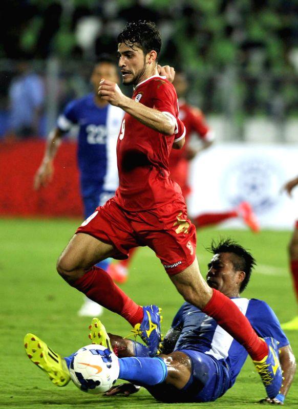 Oman footballer Abdul Aziz Al Muqbali in action during India vs Oman FIFA world cup 2018 qualifying match at Kanteerava Stadium, in Bengaluru on June 11, 2015. India lose 1-2.