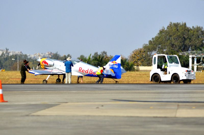 One of the two Redbull aeroplanes being attended on ground after they came dangerously close damaging their wings during an aerobatic performance at Yelahanka Air-force Station, in ...