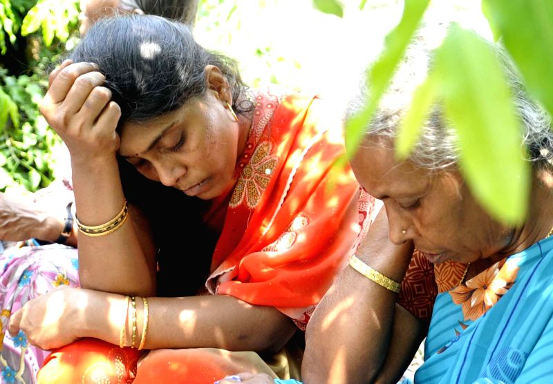 Parents of Gauthami, an 18-year-old girl student who was shot dead in her school premises by an office attendant for spurning his advances mourn her death in Bengaluru, on April 1, 2015.