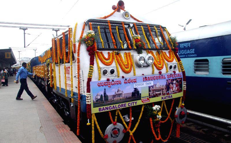 Bengaluru : Passengers abroad newly introduced trains at Bangalore City Railway Station, in Bengaluru on Jan. 29, 2015.