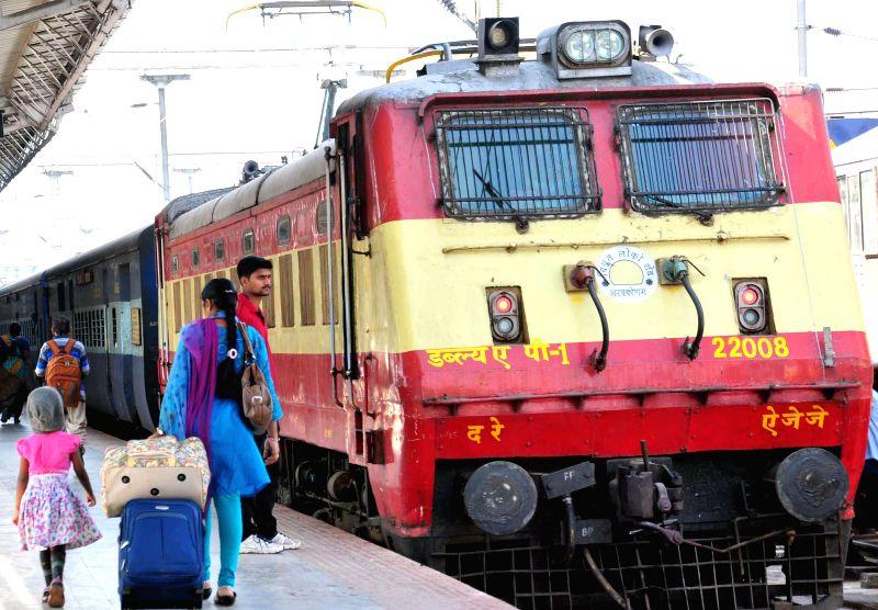 Passengers at City Railway Station in Bengaluru on Feb 26, 2015. The Union Railways Minister Suresh Prabhakar Prabhu Thursday presented the Railway Budget 2015-16 at the Parliament. - Suresh Prabhakar Prabhu Thursday