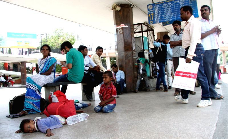 Passengers stranded at a Bengaluru bus depot during a 24-hour nationwide transport strike called by trade unions on April 30, 2015.