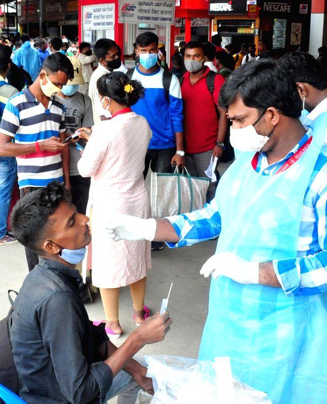 Bengaluru: Passengers wait in line to register for swab COVID-19 tests at Bengaluru Railway Station, amid ongoing Coronavirus pandemic, in Bengaluru on Friday, July 30, 2021.