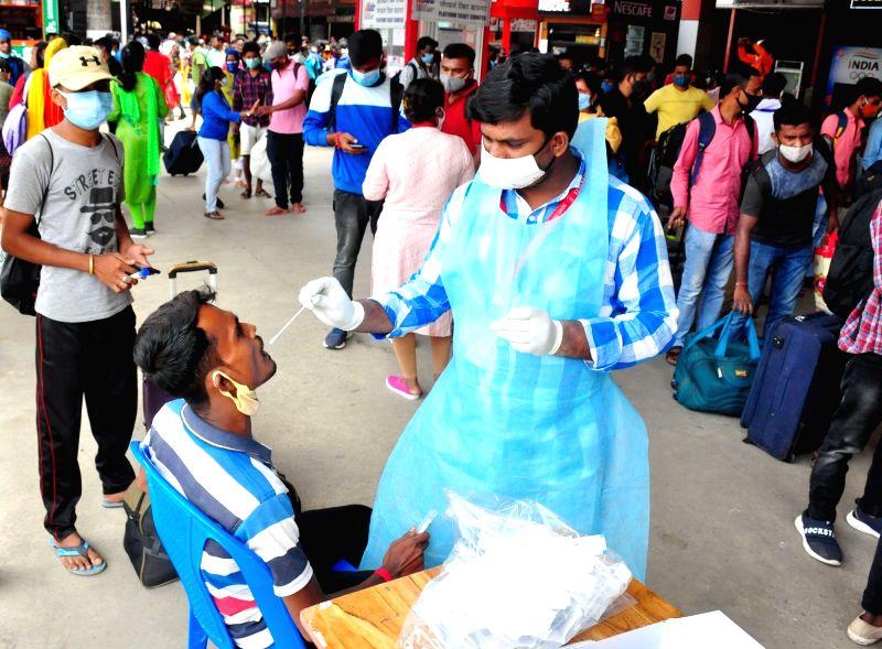 Bengaluru: Passengers wait in line to register for swab COVID-19 tests at Bengaluru Railway Station, amid ongoing Coronavirus pandemic, in Bengaluru on Friday, July 30, 2021.(Photo: IANS)