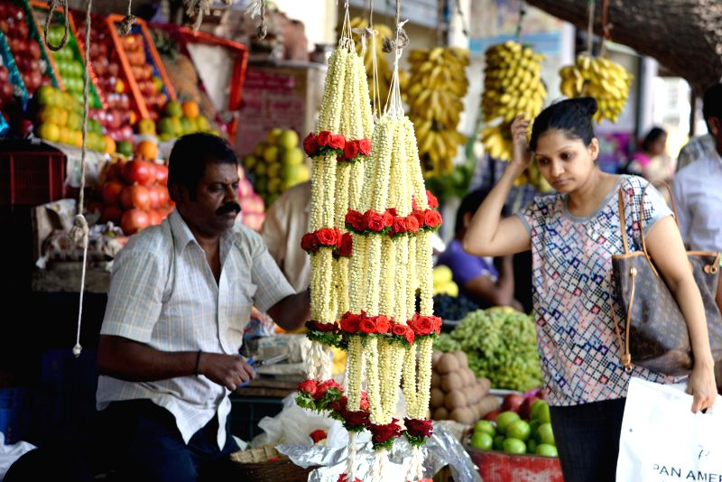 People busy shopping ahead of Ugadi festival, in Bengaluru on March 20, 2015.