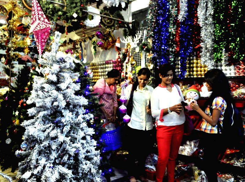 People busy with Christmas shopping in Bengaluru, on Dec 18, 2014.
