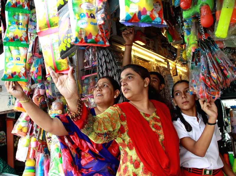 People busy with Holi shopping in Bengaluru, on March 3, 2015.