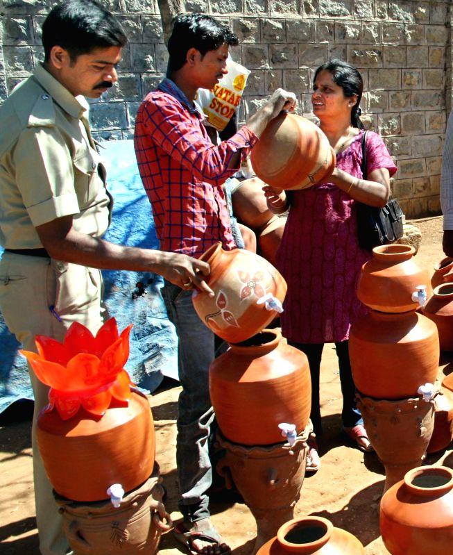 People buy earthen pots ahead of summers in Bengaluru, on Feb 27, 2015.