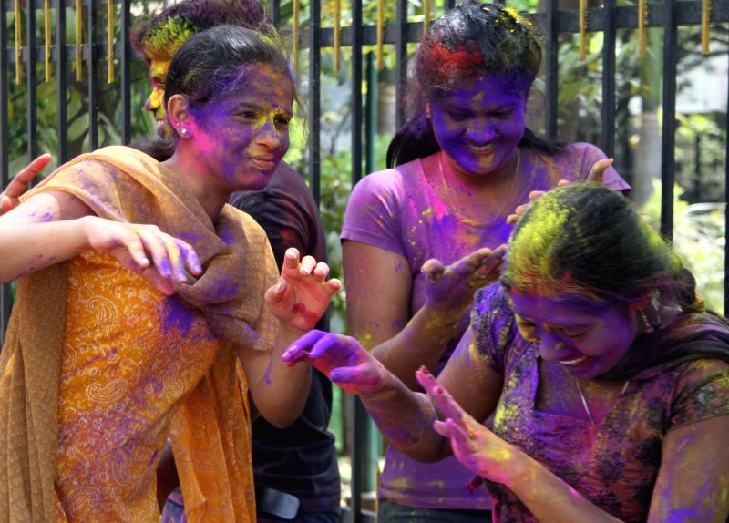 People celebrate holi in Bengaluru on March 5, 2015.