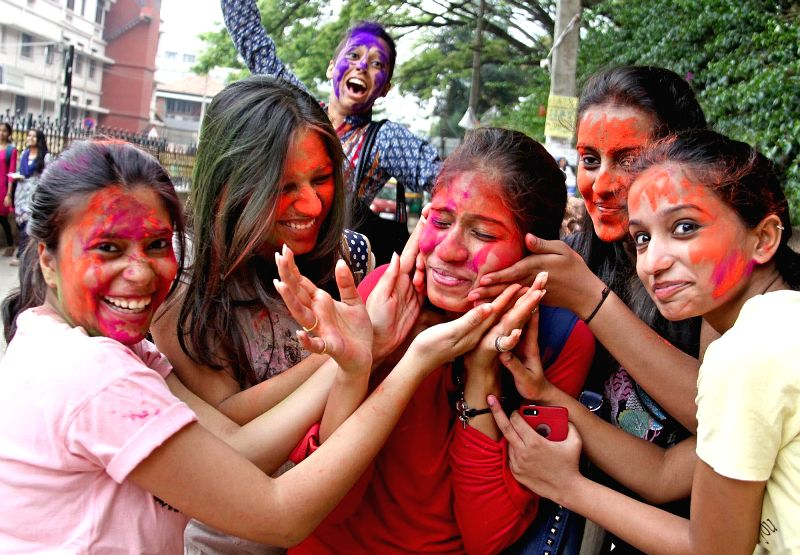 People celebrate holi in Bengaluru on March 7, 2015.