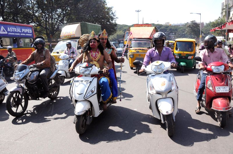 People disguise as Ram and Hanuman ride a scooter on Hanuman Jayanti, in Bengaluru, on Dec 4, 2014.