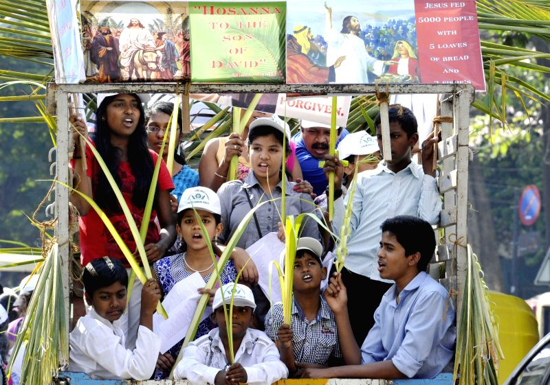 People participate in a procession organised on Palm Sunday in Bengaluru on March 29, 2015.