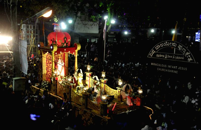 People participate in a religious procession taken out from Infant Jesus Church in Bangalore on Jan 14, 2015.