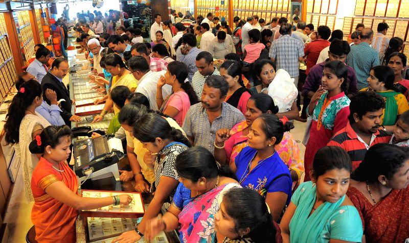 People throng a jewelery store on Akshaya Tritiya in Bengaluru, on April 21, 2015.