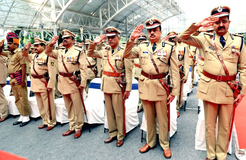 Police officers selected for president's medal for their meritorious and excellent services to the department during an investiture ceremony at Raj Bhavan in Bengaluru on Nov 26, 2014.