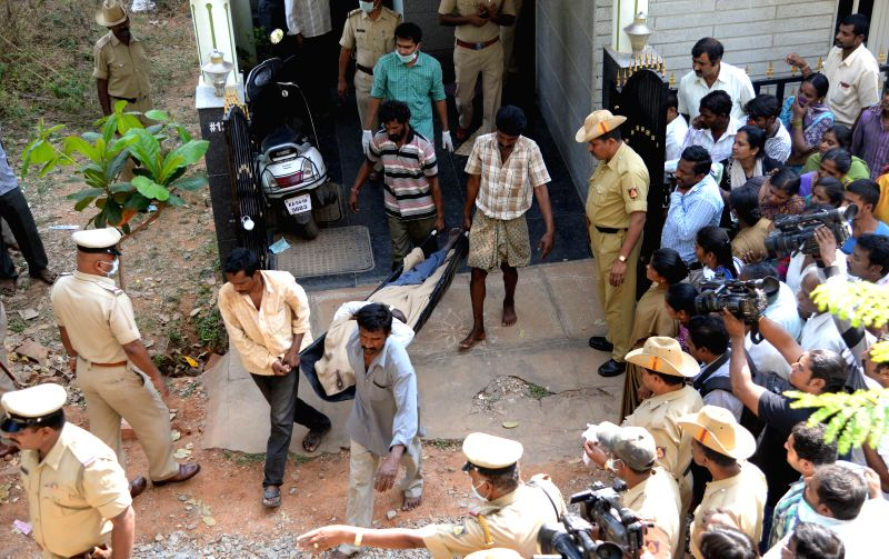 Police take away the bodies of the members of a family who committed suicide at their residence in Nagarbhavi of Bengaluru on March 12, 2015.