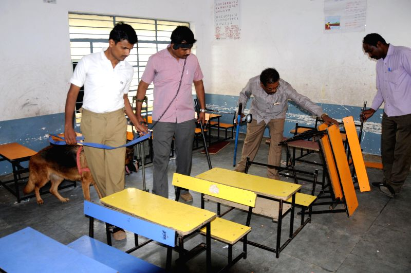 Policemen carry out investigations in the classroom of a Bengaluru school where three students were injured in a gelatin stick blast  on Jan 2, 2015.