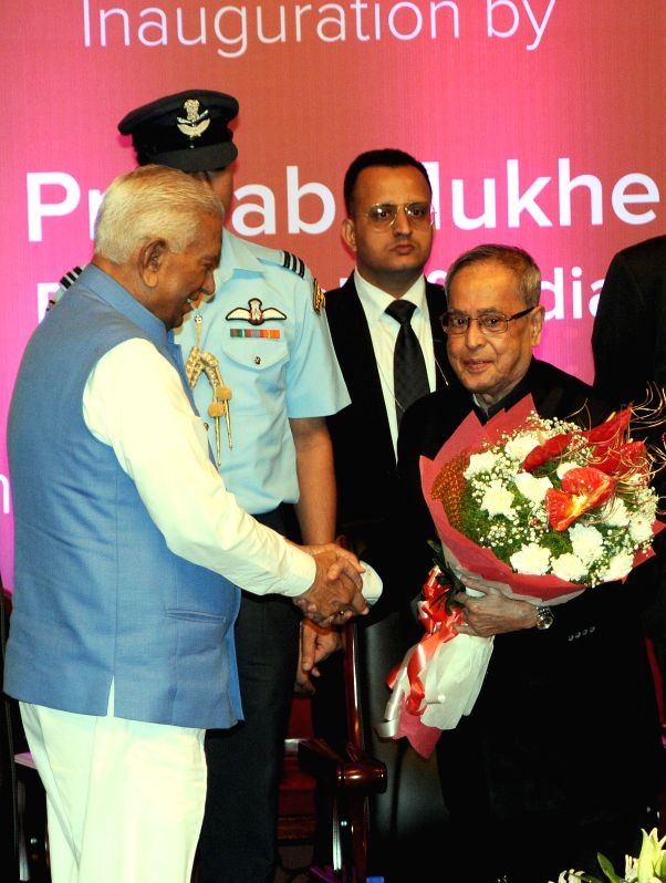 President Pranab Mukherjee with Karnataka Governor Vajubhai Rudabhai Vala during the Commonwealth Science Conference in Bengaluru, on Nov 25, 2014. - Pranab Mukherjee